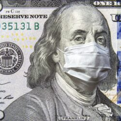 Benjamin Franklin $100 bill with a mouthmask on